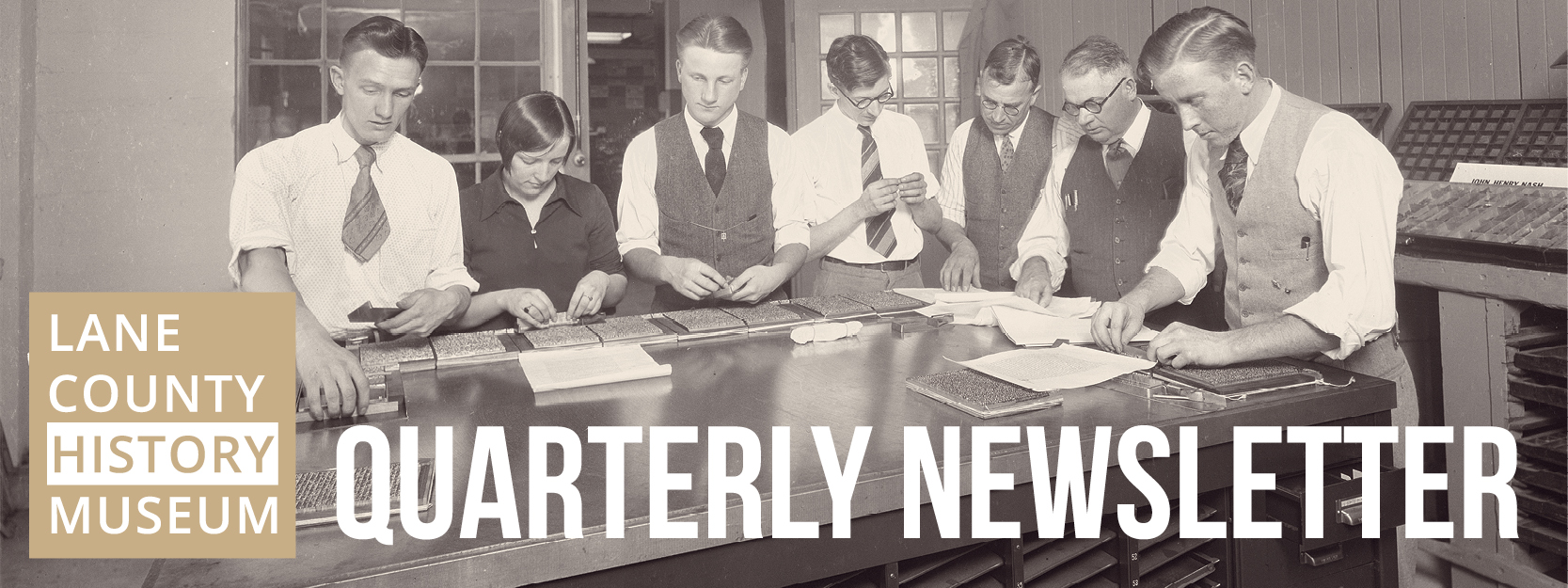 Quarterly Newsletter. Image shows students preparing type by hand.